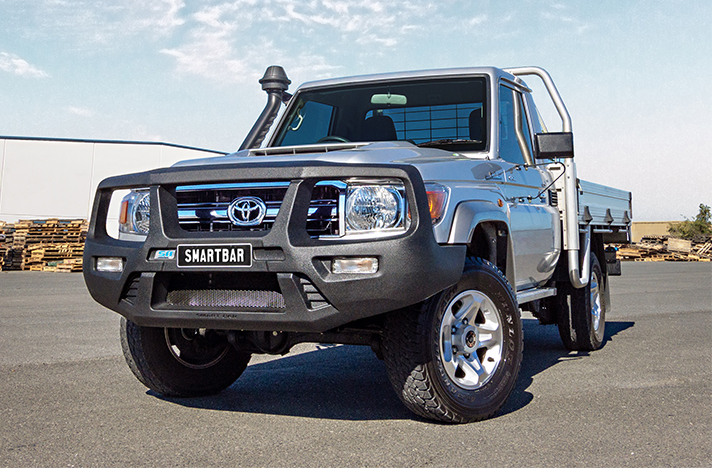 Silver Toyota LandCruiser 79 Single Cab 09-16 with a SmartBar bull bar